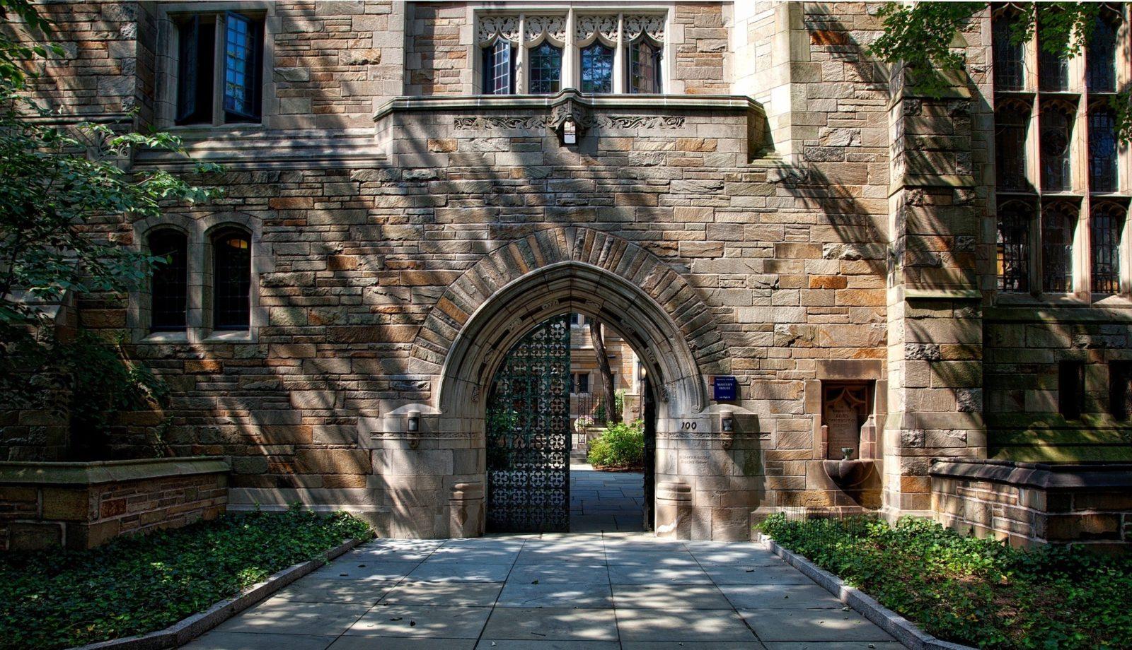steel-gate-of-brown-brick-building-159490